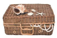 Old suitcase. Old wum suitcase and sea shells Stock Photos