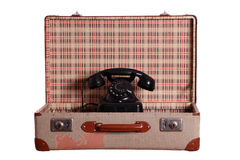 Old suitcase with aged phone Royalty Free Stock Images