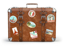 Old suitcase baggage with travel stickers isolated on white back Stock Images