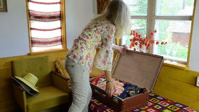 Old suitcase blouses stock video footage