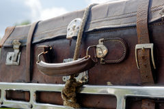 Old suitcase on the car roof rack Stock Images