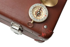 Old suitcase  and compass Royalty Free Stock Photos