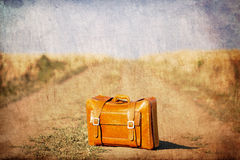 Old suitcase at country side road. Royalty Free Stock Photography