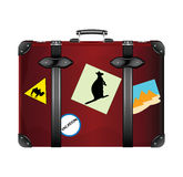 Old suitcase. Covered with stickers Royalty Free Stock Photos