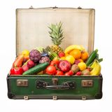 Suitcase full of fruit and vegetables stock photos