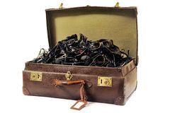 An old suitcase full of sunglasses Stock Images