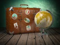 Old suitcase with globe on wood  background. Travel or tourism c Royalty Free Stock Image