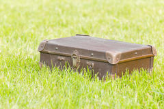 Old suitcase on grass Royalty Free Stock Photos