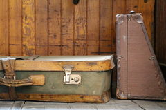 An old suitcase of green and yellow leather put on the ground Royalty Free Stock Images