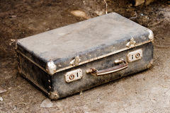 Old suitcase on the ground Royalty Free Stock Images