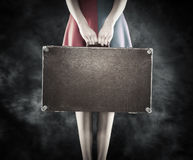 Old suitcase in hands. Stock Photos