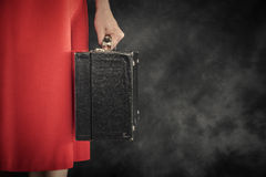 Old suitcase in hands Stock Image