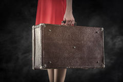 Old suitcase in hands Stock Photos
