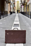 Old suitcase in the middle of the street Stock Photos