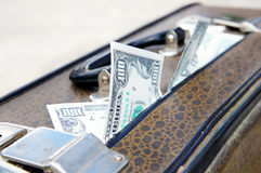 Old suitcase with money Stock Images