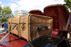 Old suitcase on retro car Royalty Free Stock Images