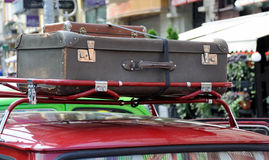Old suitcase on the roof of the car Stock Images