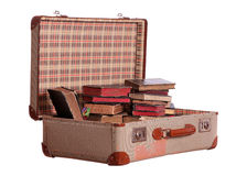 Old suitcase stuffed with old books Stock Photography