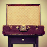 Old suitcase on a table, with a retro effect Stock Images