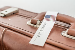 Old suitcase tagged with USA flag. Stock Images