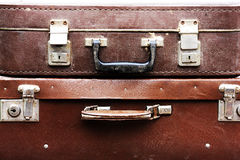 Old suitcase. Threadbare and worn brown leather Royalty Free Stock Photo