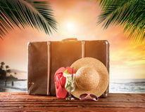 Old suitcase on tropical beach, travel concept Royalty Free Stock Images