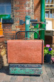 Old suitcase on vintage weighing scales Stock Image