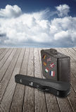 Old suitcase and violin case with striples flags from Europe Stock Images