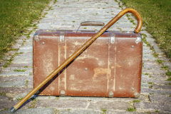 Old suitcase with walking stick Royalty Free Stock Photography