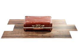 Old suitcase on wooden floor Royalty Free Stock Photos