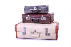 Old suitcases. Three old suitcases on white background Royalty Free Stock Image
