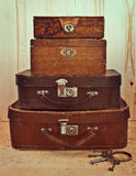 Old suitcases. And boxes stacked Stock Image