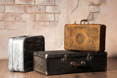 Old suitcases on the brick wall background Stock Images