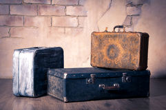 Old suitcases on the brick wall background Stock Photography