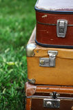 Old suitcases. Color shot of a pile of old, used suitcases Royalty Free Stock Image