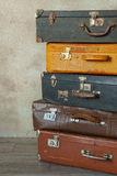 Old suitcases.Fragment. Many old suitcases stand in an empty room Royalty Free Stock Photo