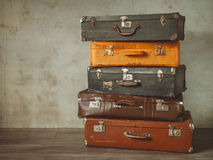 Old suitcases. Many old suitcases stand in an empty room Royalty Free Stock Photography