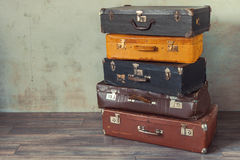 Old suitcases. Many old suitcases stand in an empty room Stock Photo