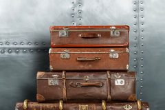 Old suitcases on metal background Stock Photos