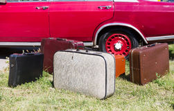 Old suitcases near the car Royalty Free Stock Photos