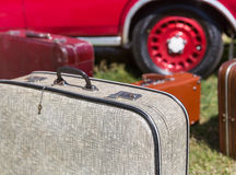 Old suitcases near the car Stock Photos