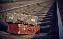 Old suitcases on rails Stock Photography