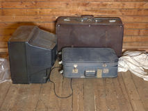 Old Suitcases And TV set Royalty Free Stock Photos