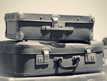 Old suitcases. Vintage travel bags. Old suitcases on the road, monochromatic toned color in retro style. Voyage on an automobile - old classic baggage. Travel Royalty Free Stock Images