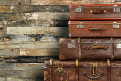 Old suitcases on wooden background Stock Photo