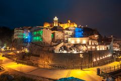 Old sulfur Baths in Abanotubani district with wooden carved balconies in the Old Town of Tbilisi at night, Georgia.  royalty free stock image