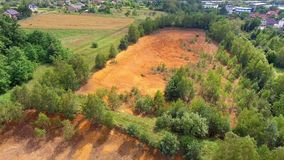 Old sulfuric acid natural tank orange color in south of Poland. View from above. Old sulfuric acid natural tank orange color in south of Poland. View from above stock video footage