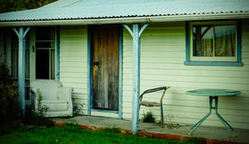 Old summer house with old chairs on the veranda Stock Photo