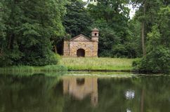 Old summerhouse at a lakeside, England Stock Image