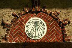 Old sundial on a building Stock Image